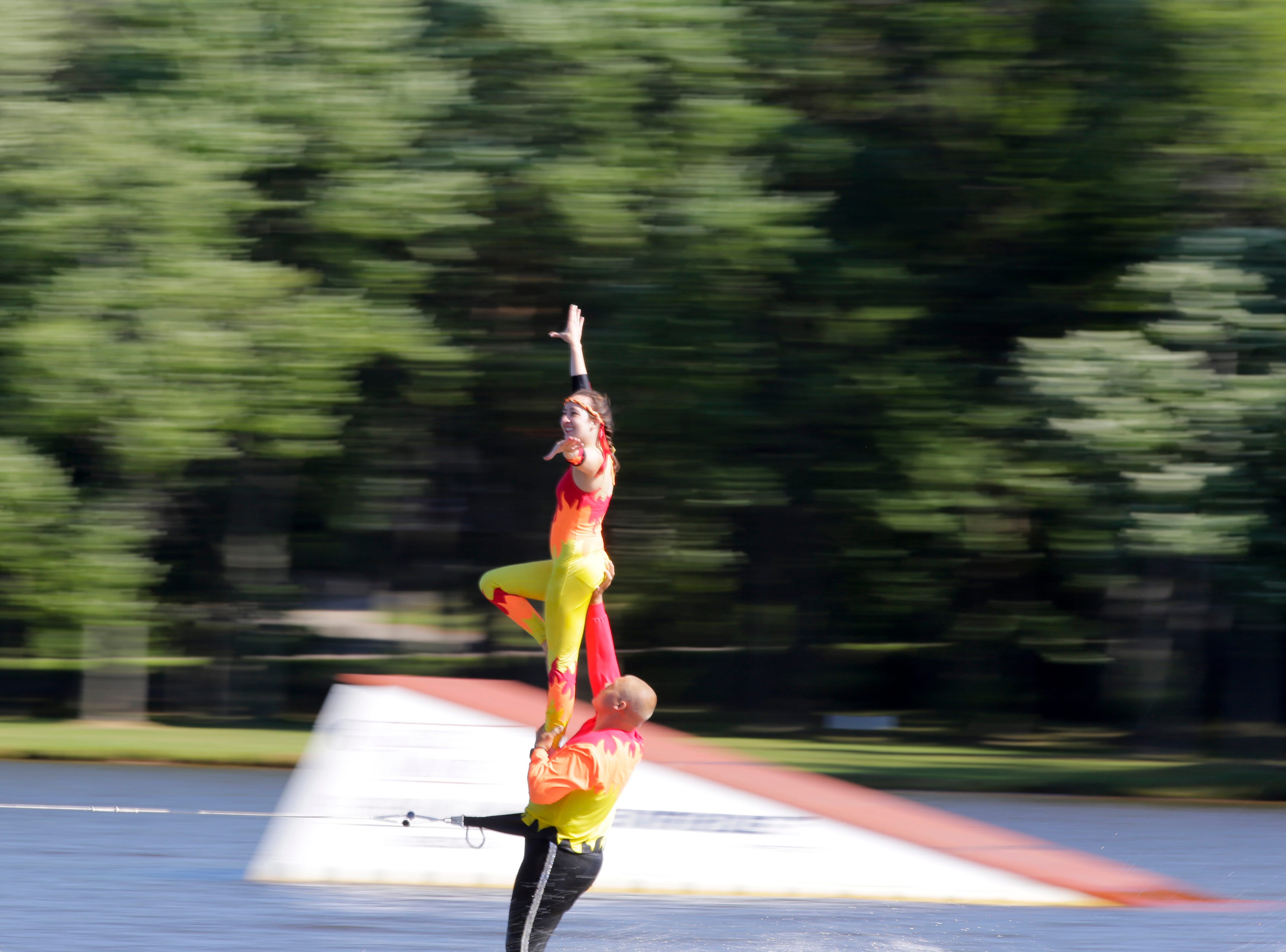 Ben and Hannah Walker compete in the doubles category during the Wisconsin State Water Ski Show Championships on Lake Wazeecha in Kellner Thursday, July 19, 2018.