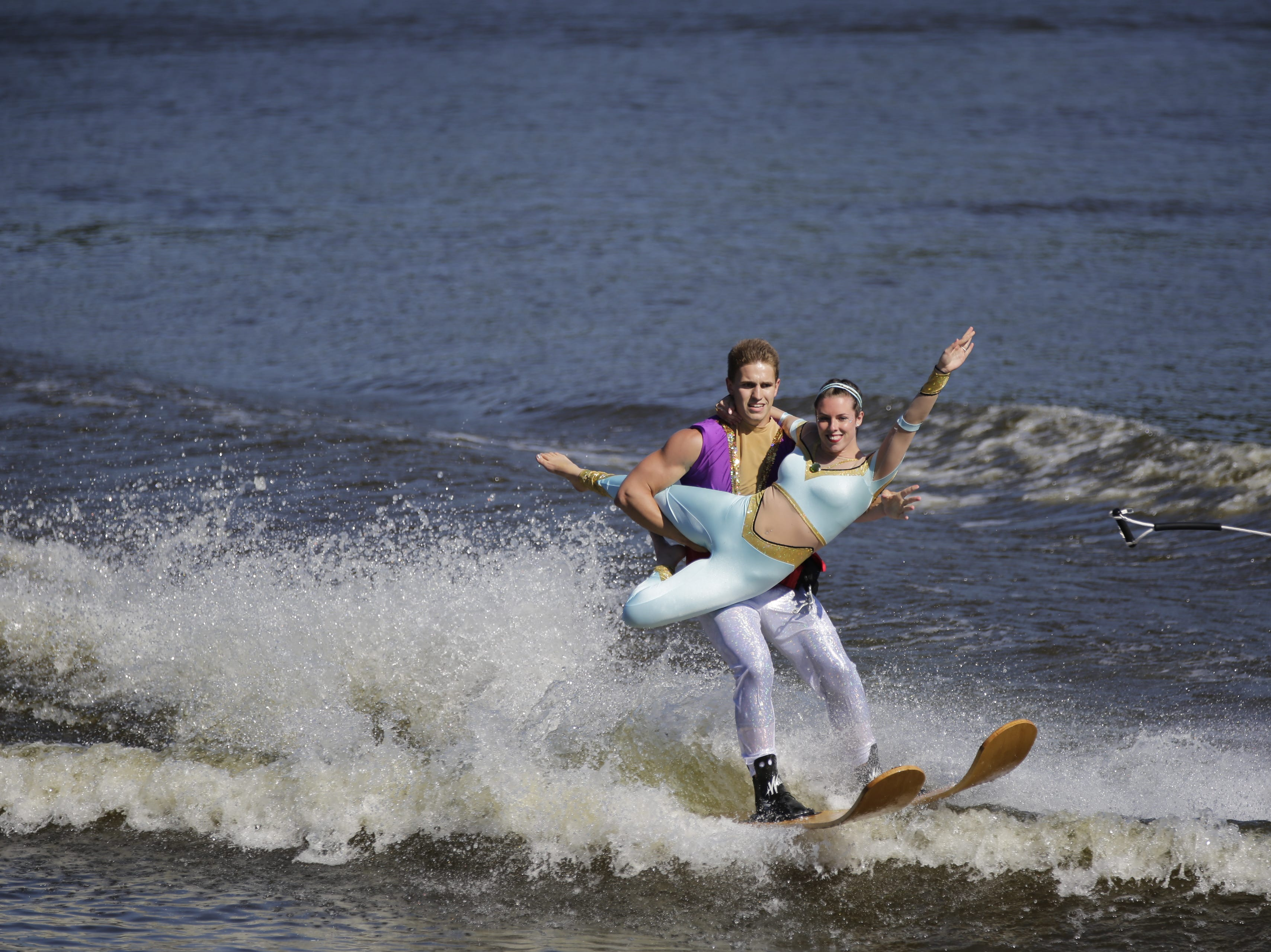 Jack Misina and Kate Draeger compete in the doubles category during the Wisconsin State Water Ski Show Championships on Lake Wazeecha in Kellner Thursday, July 19, 2018.