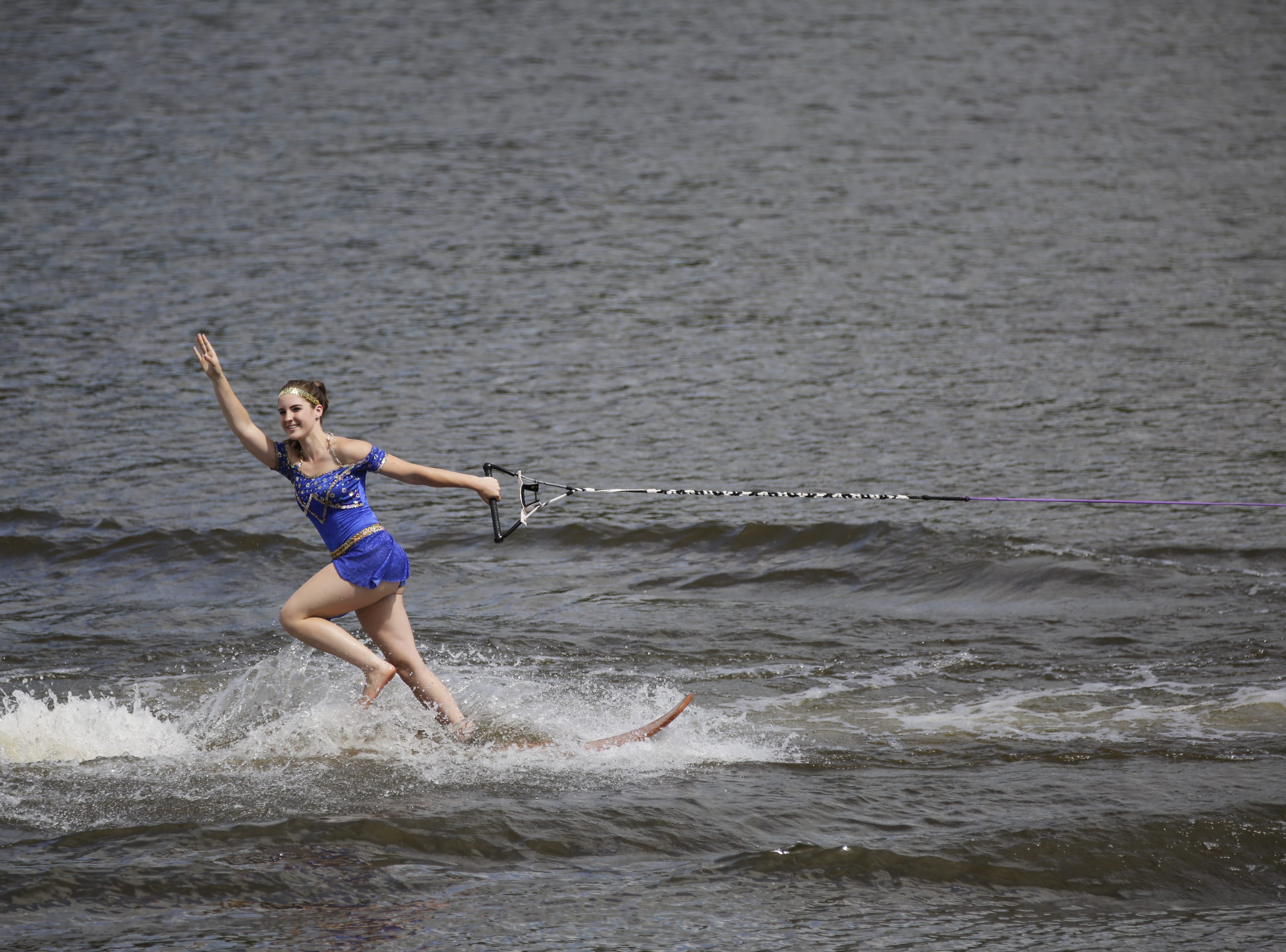 Colleen Redding competes in the swivel category during the Wisconsin State Water Ski Show Championships on Lake Wazeecha in Kellner Thursday, July 19, 2018.