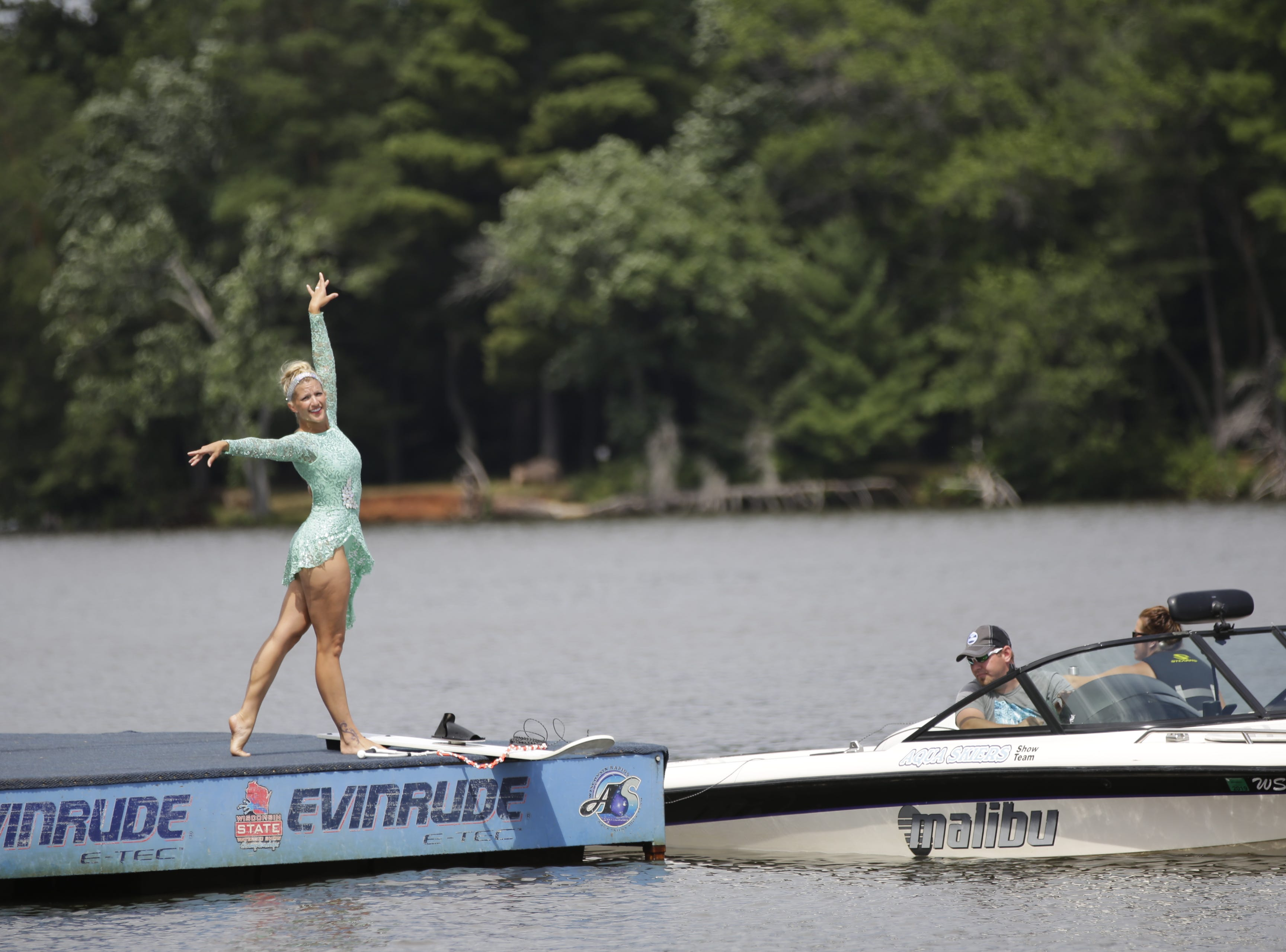 Pam Heineck competes in the swivel category during the Wisconsin State Water Ski Show Championships on Lake Wazeecha in Kellner Thursday, July 19, 2018.