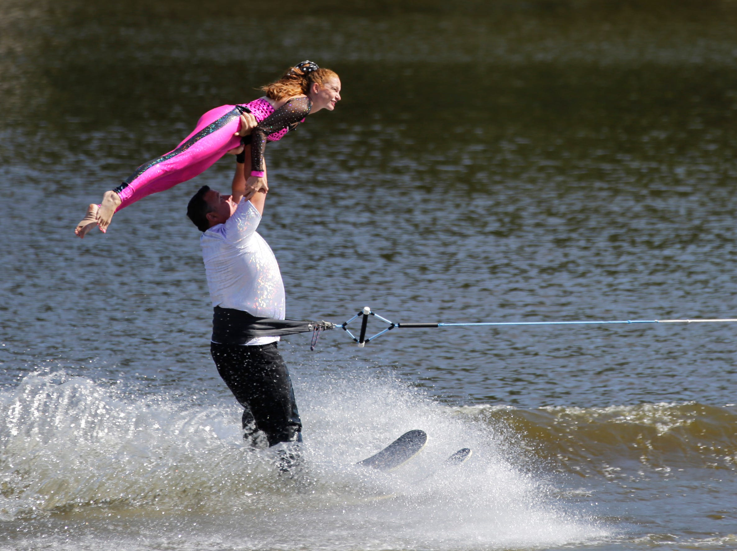 Will and Danielle Bazeley compete in the doubles category during the Wisconsin State Water Ski Show Championships on Lake Wazeecha in Kellner Thursday, July 19, 2018.