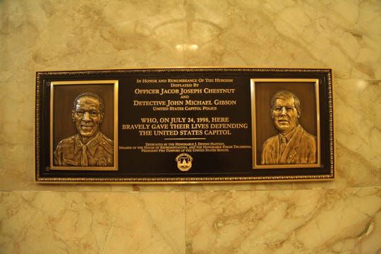 A plaque at the U.S. Capitol honors two officers who died in the line of duty in 1998.