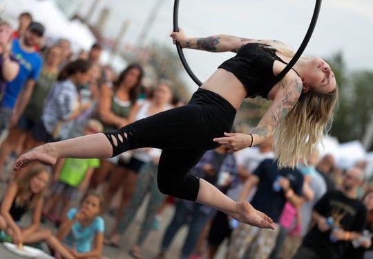 Natalie Werth of Appleton performs during Bazaar After Dark in Neenah in July.