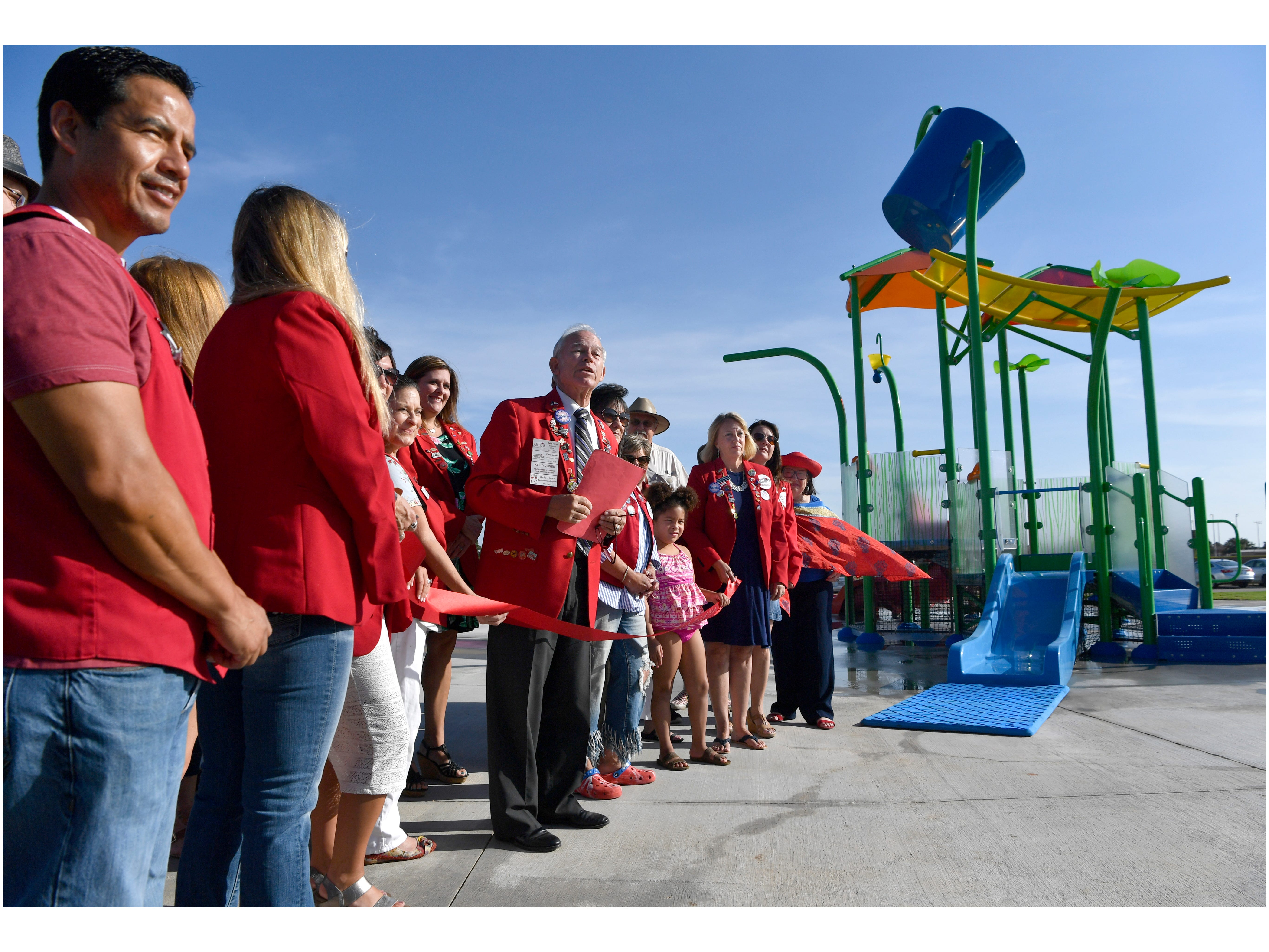 Members of the Chamber of Commerce Redcoats dedicate the Redbud Park Splash Pad Friday July 20, 2018.