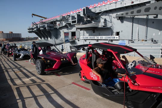 Polaris Slingshot owners from Corpus Christi, Houston and Austin drive up the ramp at the Lexington Museum on the Bay as they take part in a charity ride on Friday, July 20, 2018.