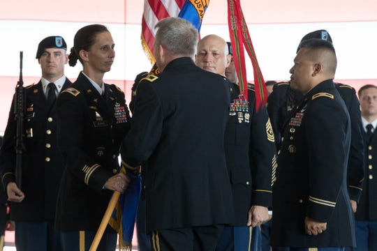 Gen. Douglas Gabram hands incoming Col. Gail Atkins the depots flag during the Corpus Christi Army Depot's change of command ceremony on Friday, July 20, 2018.