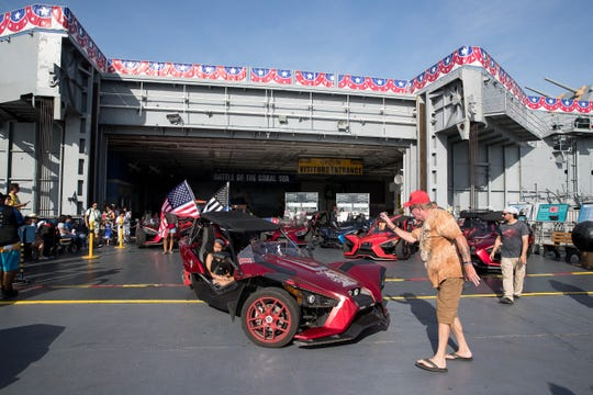 Polaris Slingshot owners from Corpus Christi, Houston and Austin park on the elevator at the Lexington Museum on the Bay as they take part in a charity ride on Friday, July 20, 2018.