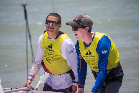 JC Hermus (left) and Walter Henry drag their boat on shore after winning the 420 boys class on the final day of the Youth World Sailing Championships in Corpus Christi Bay on Friday, July 20, 2018.