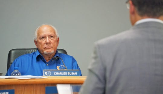 Port Aransas Mayor Charles Bujan listens to Port of Corpus Christi CEO Sean Strawbridge address the City Council on July 19, 2018. Strawbridge and other port staff were in attendance to address concerns about a pending permit application the port has with the TCEQ for a seawater desalination plant on Harbor Island.
