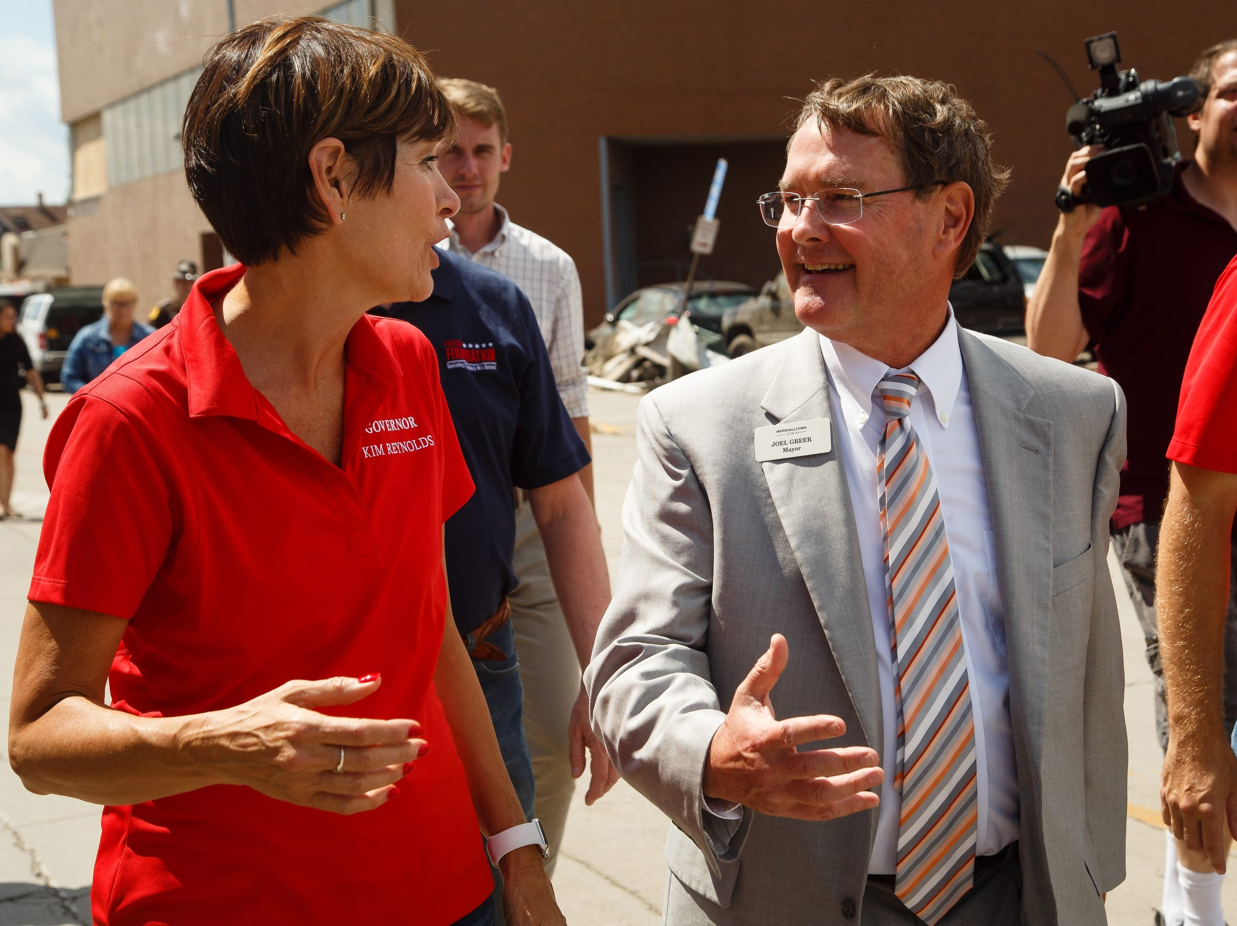 Marshalltown Mayor Joel Greer, right, shows Iowa Governor Kim Reynolds the damage in Marshalltown on Friday, July 20, 2018. Yesterday, tornadoes ripped through central Iowa causing major damage but only minor injuries have been reported so far.