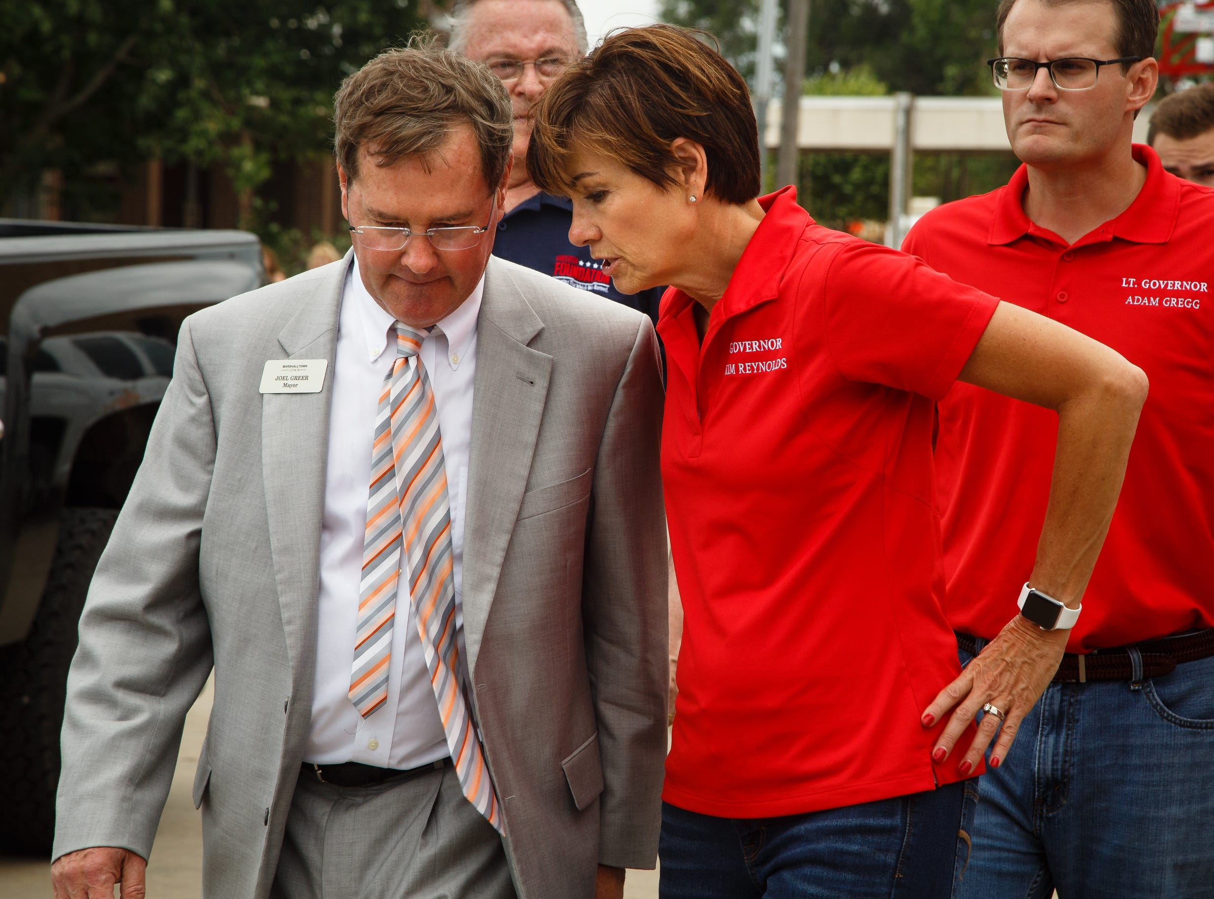 Marshalltown Mayor Joel Greer, left, shows Iowa Governor Kim Reynolds the damage in Marshalltown on Friday, July 20, 2018. Yesterday, tornadoes ripped through central Iowa causing major damage but only minor injuries have been reported so far.