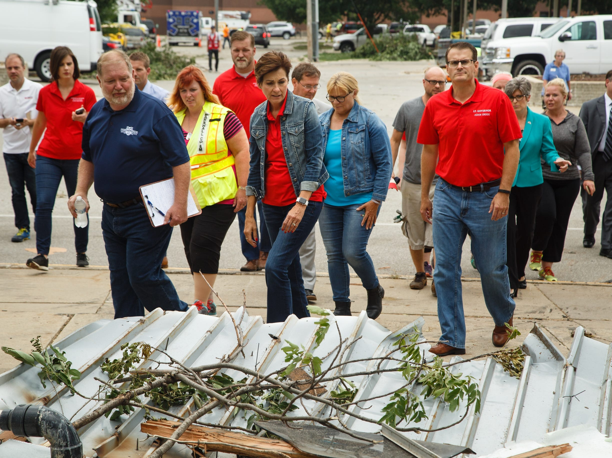 Iowa Governor Kim Reynolds tours the damage in Marshalltown with Lt. Gov. Adam Gregg, right, on Friday, July 20, 2018. Yesterday, tornadoes ripped through central Iowa causing major damage but only minor injuries have been reported so far.