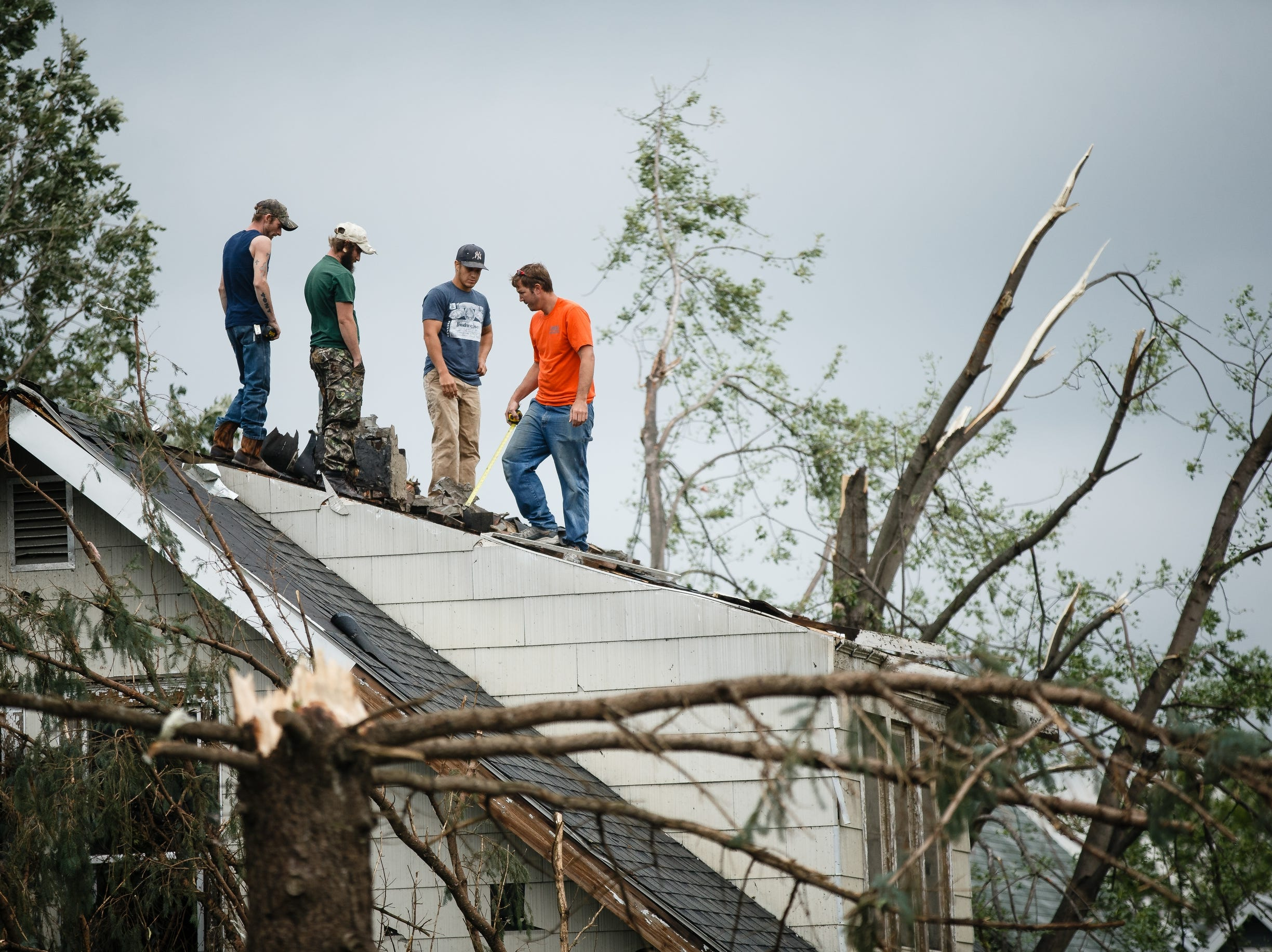 People continue to clean up after a tornado swept through Marshalltown on Friday, July 20, 2018.