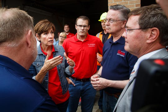 Iowa Governor Kim Reynolds, left, arrives to tour the damage in Marshalltown with Lt. Gov. Adam Gregg, center, Sen. Joni Ernst, not pictured, and Rep. Rod Blum, second from right on Friday, July 20, 2018. Yesterday, tornadoes ripped through central Iowa causing major damage but only minor injuries have been reported so far.