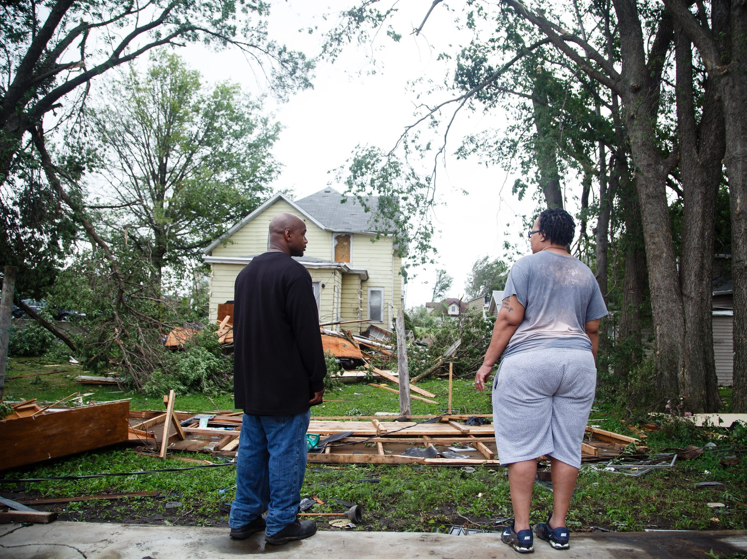 """I don't know what to say,"" said Jerome McDowell, left, as he and Kassandra McDowell, right, clean up after a tornado swept through Marshalltown on Friday, July 20, 2018. ""We were blessed,"" he added after they received only minimal damage despite being in one of the worst hit parts of town."