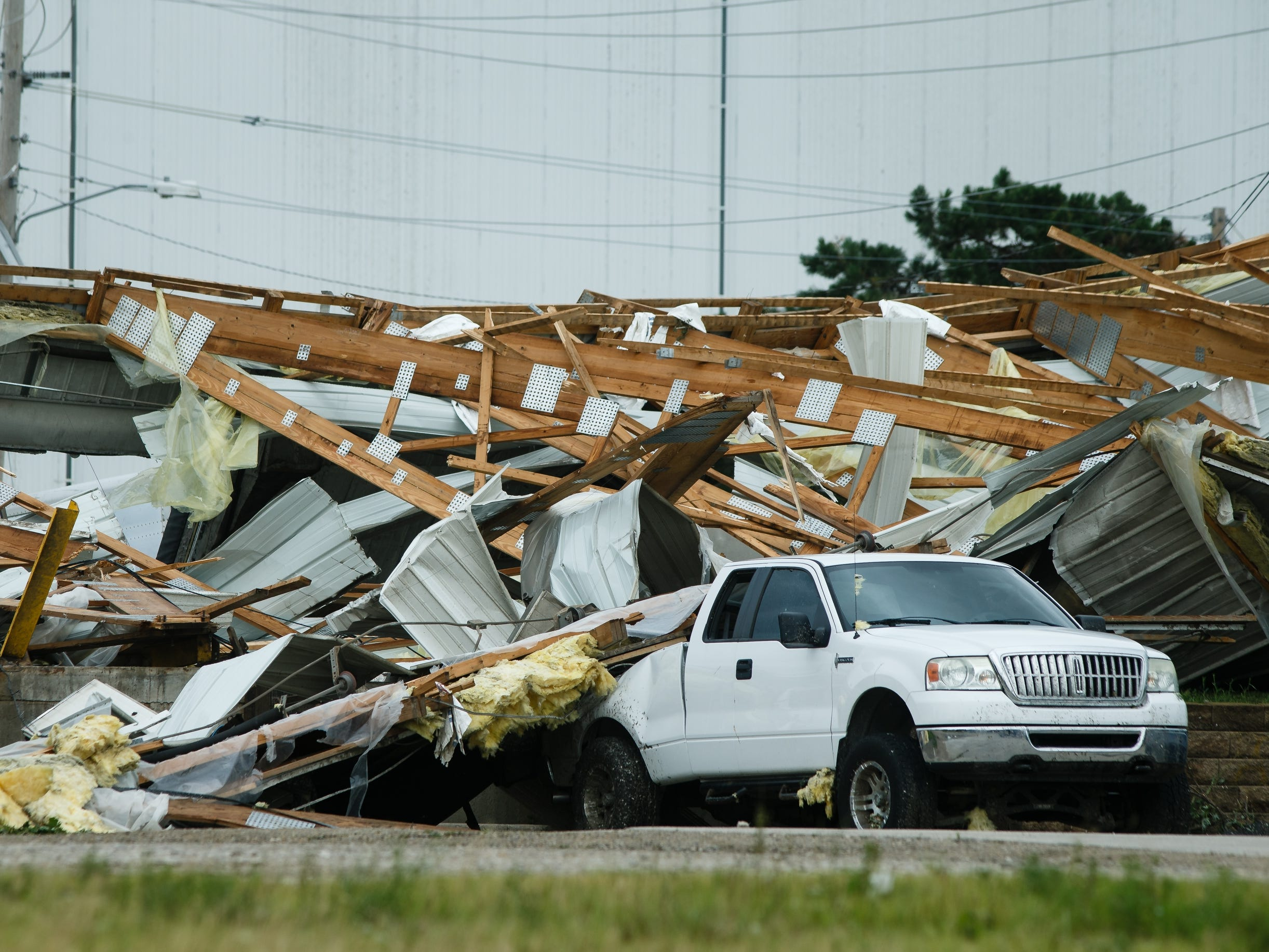 Debris from a factory hit by the tornado lays on a truck on Friday, July 20, 2018.
