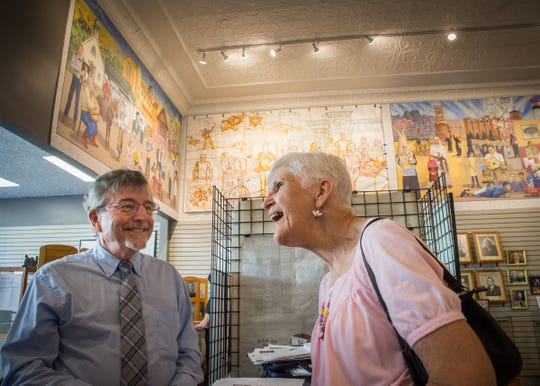 Joan Barrios of Hamtramck speaks with artist Dennis Orlowski at the Hamtramck Historical Museum in Hamtramck on Thursday, July 19, 2018.