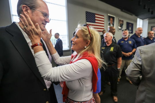 Congresswoman Debbie Dingell embraces United Auto Workers President Gary Jones at the town hall to discuss pensions at the Teamsters Health and Welfare Building in Detroit on Friday, July 20, 2018. On Monday, they embraced again when the UAW honored the work of Congressman John Dingell.