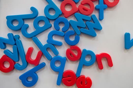 Letters are jumbled together on a whiteboard at Rocky Mountain Camp in Evergreen on Wednesday, July 18, 2018. The camp for kids with dyslexia specializes in overcoming reading and writing disabilities.