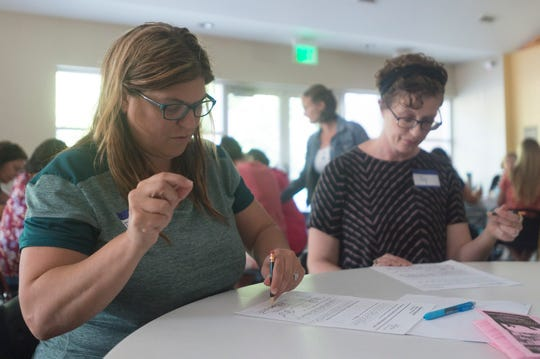Dana Clark, a special education teacher in Weld County School District, uses her non-dominant hand during a dyslexia simulation at Spirit of Joy Lutheran Church on Wednesday, July 18, 2018. A group of educators and parents gathered to better understand struggles of students with reading and writing difficulties.
