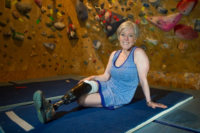Tracy Hickey poses for a photo in her basement climbing gym at her Fort Collins home on Tuesday, July 17, 2018. Hickey decided to donate her amputated leg to search and rescue after a climbing accident in Wyoming.
