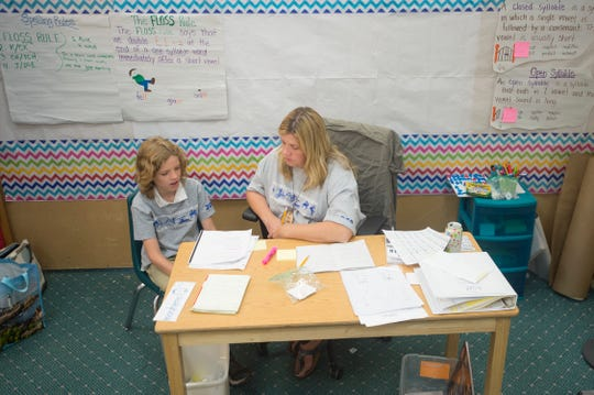 Will Raguet-Schofield works with tutor, Kathy Ulibarri, at Rocky Mountain Camp in Evergreen on Wednesday, July 18, 2018. Raguet-Schofield, 8, is attending the camp for kids with dyslexia to get some extra help learning to read.