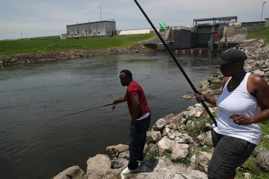 Anglers fish for crappie at an outflow from Lake Okeechobee in the Clewiston area. Lake levels are lower at this point in the year than they have been since 2011. Andrew West/The News-Press