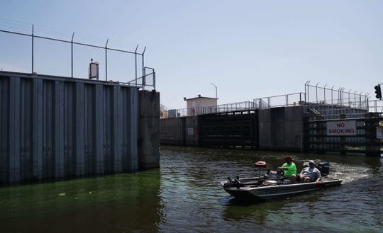 A patch of algae can be seen at a lock in Clewiston during the summer of 2018. Environmental groups and indigenous leaders are planning a walk around the lake to raise awareness about water quality.