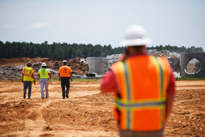 Construction crews work at the site of the planned expanded commercial cargo area and warehouse at Greenville Spartanburg International Airport in July.