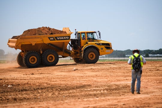 Construction crews continue work at the site of what will be an expanded commercial cargo area and warehouse at Greenville Spartanburg International Airport on Friday, July 20 2018.