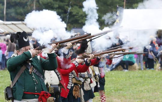 Members of the Northwest Territory Alliance with tactical demonstration during the Feast of the Hunters' Moon  at Fort Ouiatenon in Lafayette.