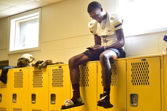 Jarrian Jones, safety for the Northwest Rankin High School football team listens to coach Britt Rowell, off camera, joke about Jones' during an interview in their locker room. Wednesday, July, 11, 2018.