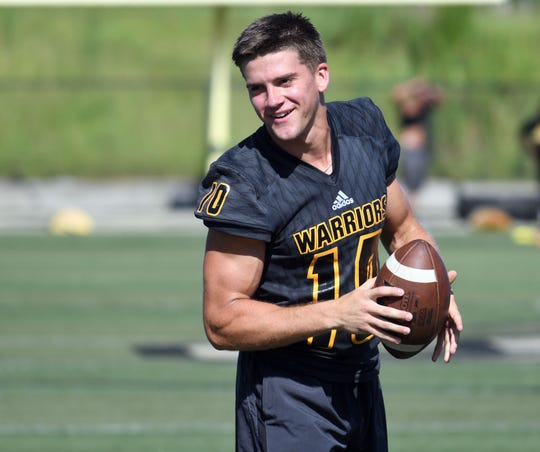 John Rhys Plumlee is going into his senior year as quarterback for the Oak Grove Warriors.