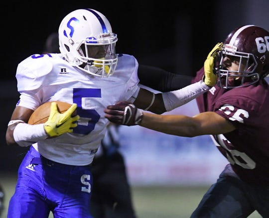 Sumrall wide receiver Dannis Jackson pushes off a defender in a game against FCAHS in 2017.