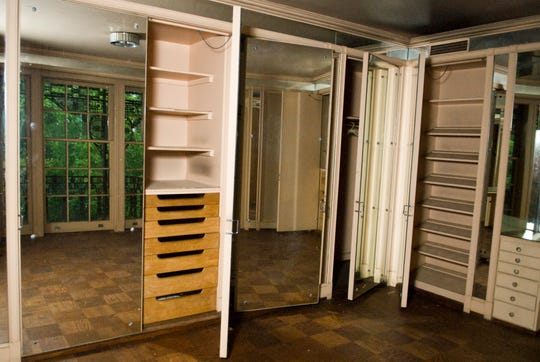 The changing room at the Eugenia Williams House features a vanity and storage closets with shelves, drawers and floor to ceiling doors with mirrors. The 10,800 square foot Eugenia Williams House at 4848 Lyons View Pike in Knoxville was willed to the University of Tennessee in 1998.