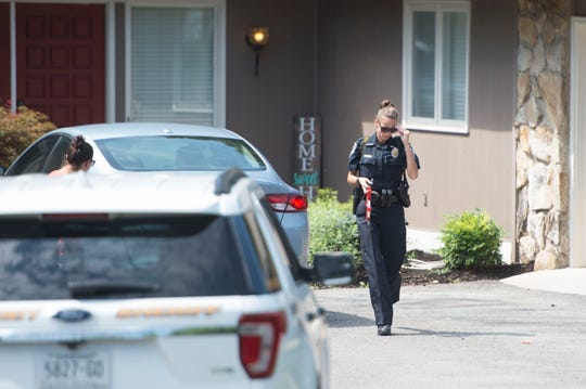 A law enforcement officer leaves the West Knoxville house where two children were pulled from a pool on Friday, July 20, 2018.