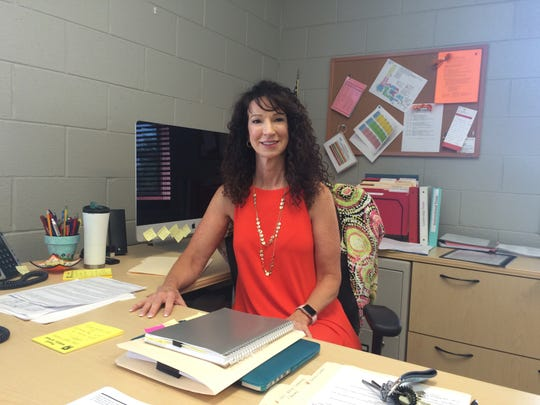 Dr. Beth Howard gets settled into her role as principal at Powell Middle School in July 2018.