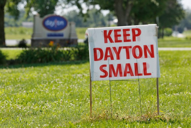 Keep Dayton Small sign in front of Dayton United Methodist Church Friday, July 20, 2018, along Dayton Road in Dayton. The signs, which can be spotted in lawns throughout the small community, are in opposition to a proposed subdivision to be built just south of the church's property.