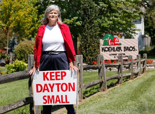 Cindy Marsh, vocal opponent of proposed development, Friday, July 20, 2018, along Dayton Road in Dayton. The proposed development is approximately a half mile south of her property.