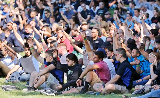 Explorers that are considering a career in law enforcement raise their hands during demonstration day Friday, July 20, 2018, as part of the National Law Enforcement Exploring Conference on the campus of Purdue University.