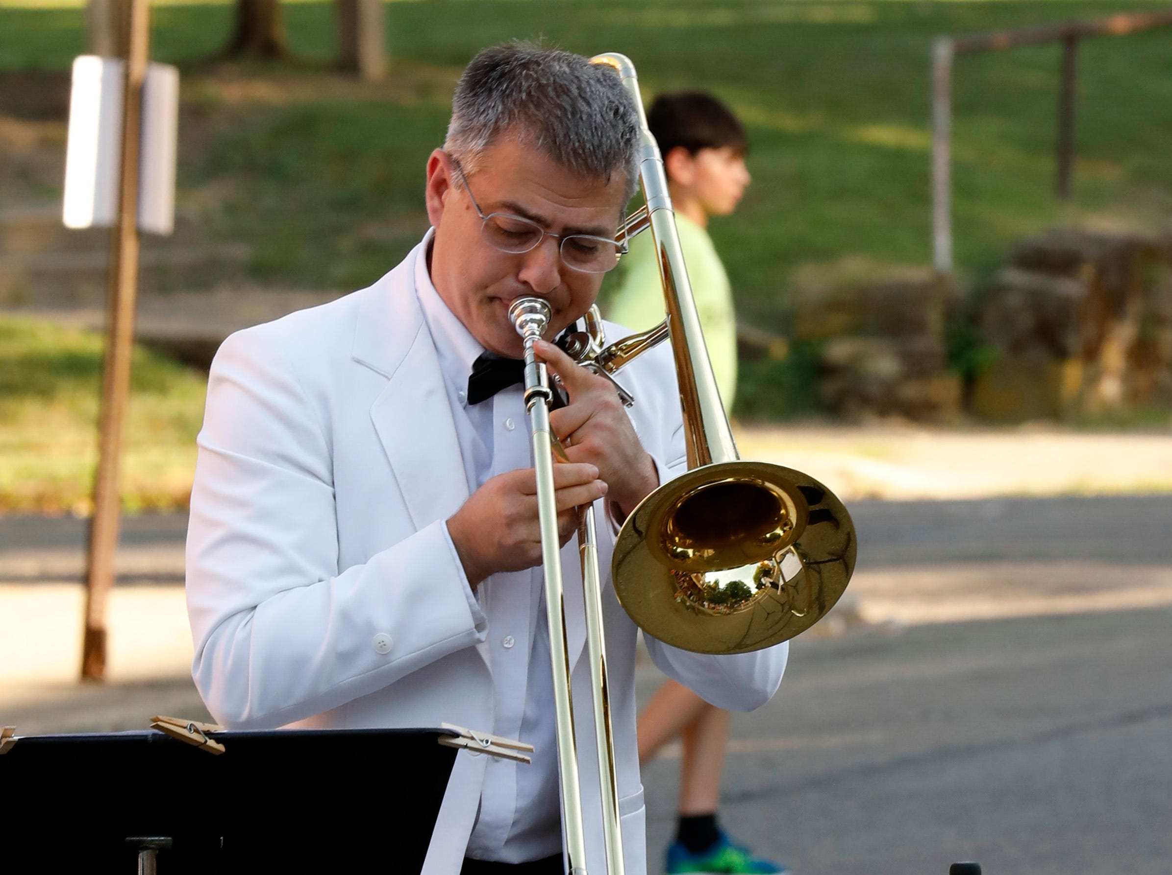 Memebers of the Lancaster Festival Orchestra low brass quartet performed a brass fanfare before the opening night concert Thursday evening, July 19, 2018, in front of St. Mary of the Assumption Roman Catholic Church in downtown Lancaster.