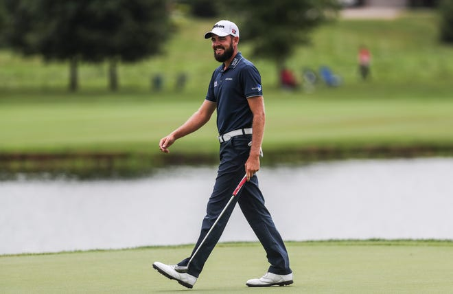 PGA player Troy Merritt smiles while on the Ninth green in the Barbasol Championship Friday. Merritt finished -15 under after two days, leading the field as he shot a 67.