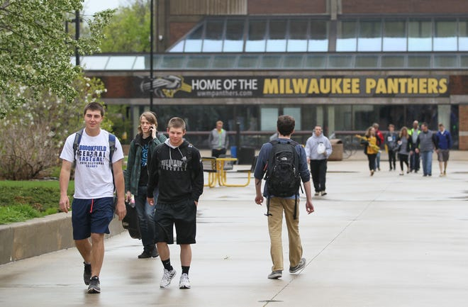 UW-Milwaukee students walk on campus. T