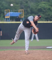 Plymouth pitcher Holden Reilly delivers a pitch in a state semifinal against Muskego on July 20, 2018.