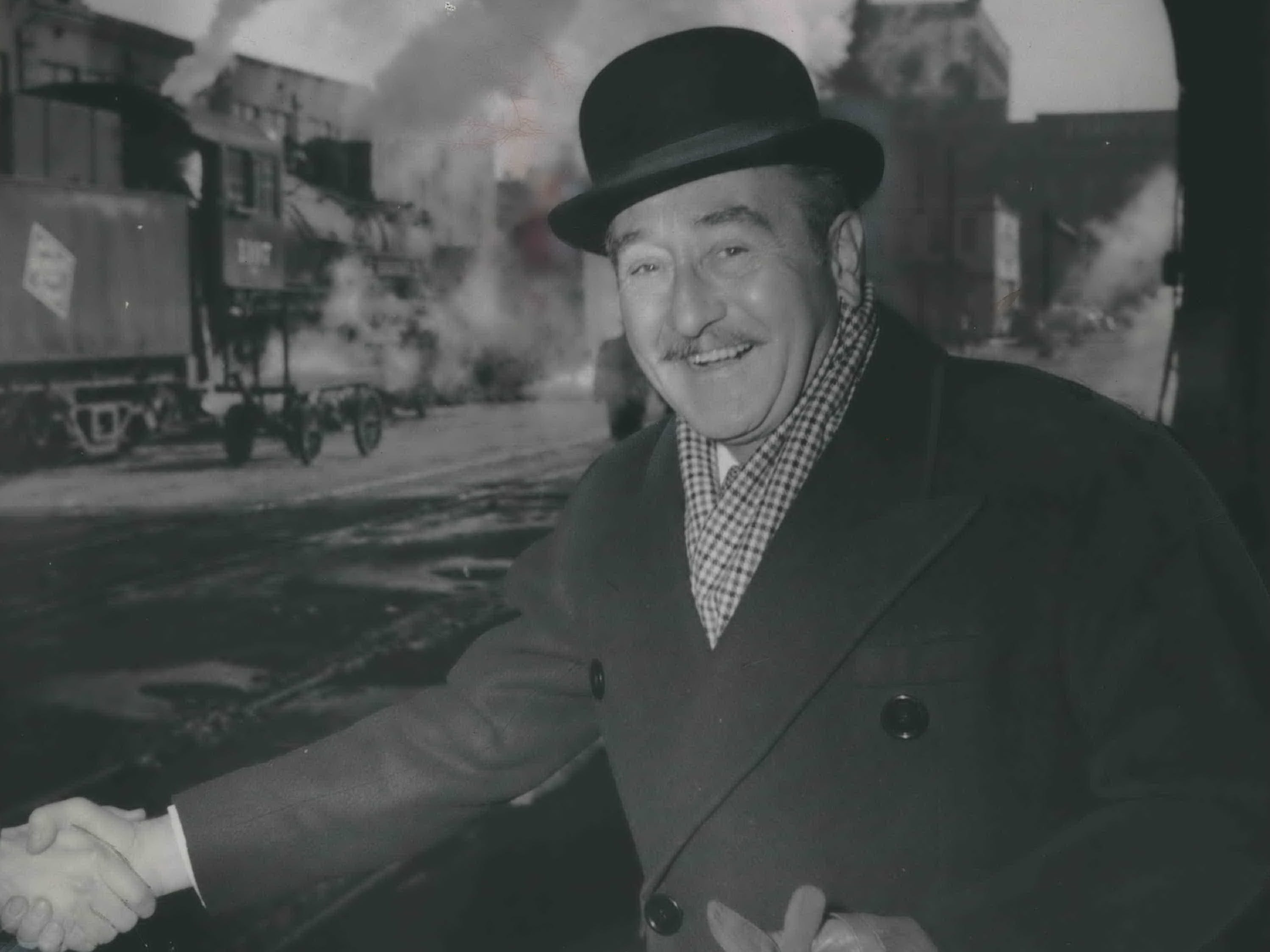 Stage and screen veteran Adolphe Menjou is greeted at the Milwaukee Road Depot in downtown Milwaukee on March 11, 1948. The dapper, Oscar-nominated actor came to town for several appearances, including one on The Milwaukee Journal's new television station, WTMJ-TV. This photo was published in the March 11, 1948, Milwaukee Journal.