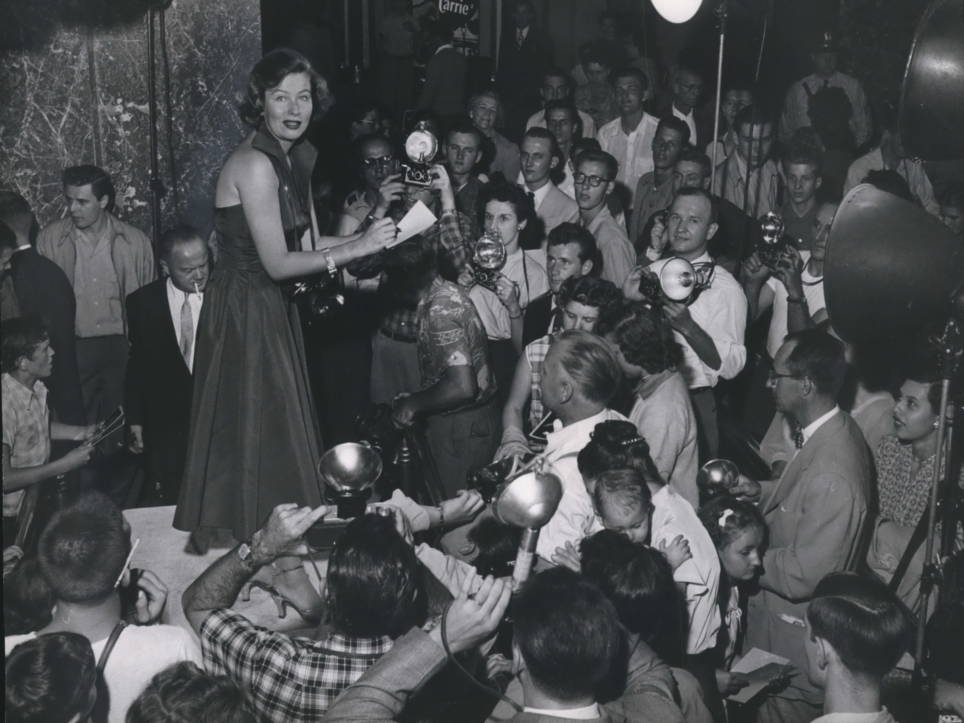 "Actress and Milwaukee native Nancy Olson is surrounded by camera-toting fans at Milwaukee's Warner Theatre on Sept. 11, 1952. Olson was nominated for an Oscar for her performance in the 1950 movie ""Sunset Boulevard,"" and appeared in a string of TV series and movies, including the 1961 comedy ""The Absent-Minded Professor."" This photo was published in the Sept. 12, 1952, edition of The Milwaukee Journal."