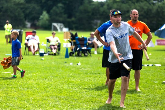 A member of Kubb Life, a Milwaukee-based kubb league, tosses the baton during the U.S. National Kubb Championship in Eau Claire, Wis., July 15, 2018.