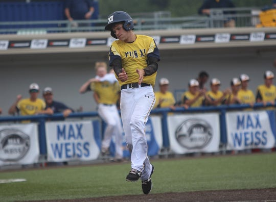 Pius XI sophomore Logan Rademan reacts while scoring a run against Menomonee Falls in a state semifinal on July 20, 2018.