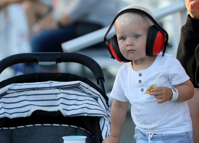 Braxton Raasch of Menomonee Falls watches the Milwaukee Mile Street Drags with his parents on July 17.