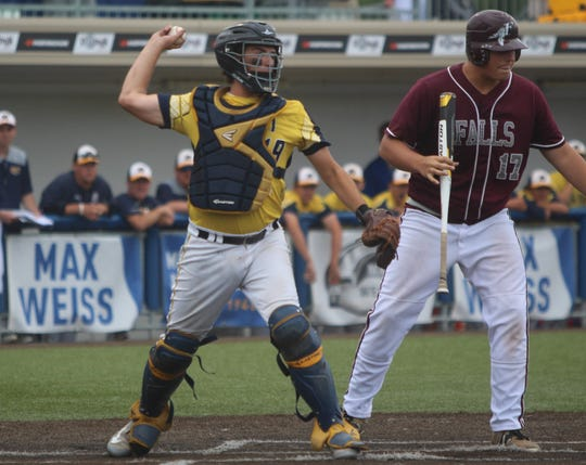 Pius XI catcher Gino D'Alessio fires to first base in a state semifinal against Menomonee Falls.